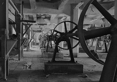 steel wheels (jkatanowski) Tags: abandoned forgotten industry indoor industrial decay dust postindustrial mess lowlight exploration urbex urban poland europe sony a7m2 1740mm bw