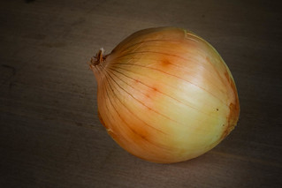 Onion close up on wood background , Vegetable