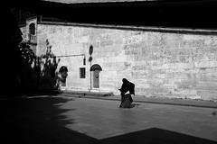 Oldwoman... (K.BERKİN) Tags: woman walk eminonu turkey tourism oldcity oldistanbul oldwoman people alpha street streetphoto streetphotograpy sony6300 shadow dark goldenhorn human life blackwhite istanbul city bosphorus mirroless