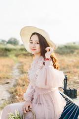 DSC_0177 (tungson.nguyen) Tags: girl woman vietnamese hat backlit dress film portrait sunshine grass