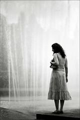 A une passante (Nil!) Tags: brazil bw woman film girl brasil 35mm solitude saopaulo sopaulo minoltax700 pb sampa entretantos fontain ipiranga agfaapx100 flneur rokkor58mmf14 unepassante theinterestingest pb41