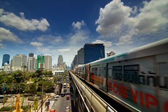 BTS #4 Leaving Station (kktp_) Tags: sky clouds d50 thailand nikon traffic bangkok taxi tokina explore skytrain bts lovephotography tokinaatx124afprodx1224mmf4 explore24aug06