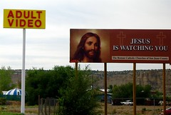 Juxtaposition:  Farmington, New Mexico (   giamarie  ) Tags: signs newmexico video interestingness jesus billboard explore porn signage pornography juxtaposition farmington romancatholic adultvideo top20signs giamarie jesusiswatchingyou