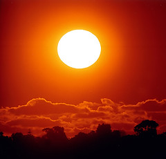 big sun-ta =) (hobbesken) Tags: trees light sunset orange sun silhouette clouds circle colours australia perth 600mm