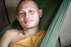 Ratha (mboogiedown) Tags: world travel smile asian pagoda asia cambodia cambodian kim buddhist south faith religion belief content monk buddhism east experience hammock siesta rest southeast tradition vat wat monastic battambang sangha robes developing ratha dhamma kampuchea cambogia theravada khmersmile camboge beatravelernotatourist itsallaboutthepeople savanaphum rathakim livingfaith ifthephotographerisinterestedinthepeopleinfrontofhislensandifheiscompassionateitsalreadyalottheinstrumentisnotthecamerabutthephotographer~evearnold