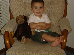 Corinne with his monkey, 18 months