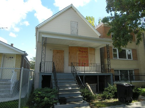 Boarded-up home, 6000 block, S Artesian Ave