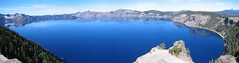 Crater Lake Panoramic (Ryan Hadley) Tags: blue trees autostitch panorama cliff usa lake mountains reflection nature clouds oregon landscape island nationalpark panoramic rockface crater caldera cascades craterlake alpinelake wizardisland cascademountains craterlakenationalpark llaorock thewatchman rimdrive mountthielsen garfieldpeak hillmanpeak redcone timbercrater applegatepeak mountbailey southcascades