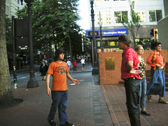 free hugs (Zervas) Tags: orange leather oregon square portland pants pdx hugs pioneer pioneersquare leatherpants leath hugger freehugs