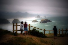 Visitors of Haystack Rock (LaserGuided) Tags: ocean statepark park sea sky film beach water topv111 rock clouds oregon interestingness waves pacific northwest haystack cannon cannonbeach ecola rebel2k i500 interestingness144 archive006