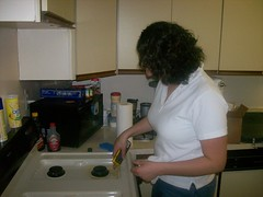 Mel cleaning the stove (Jym Ferrier) Tags: cleaning mel
