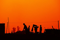Men at Work ( Poras Chaudhary) Tags: sunset red orange india men topf25 silhouette work wow geotagged kurukshetra abigfave geo:lat=29888280933159265 geo:lon=7678173065185547