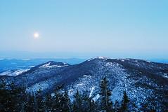 Blue Moonrise Over Bald Peak and Lake Champlain (Mountain Visions) Tags: longexposure nightphotography copyright mountain ny newyork film night forest hiking c peak adirondacks moonrise newyorkstate wilderness forestpreserve plattsburgh adk lakechamplain nocturn daks highpeaks baldpeak foreverwild ist35mm mountainvisions