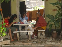 Monk chatting with Thais
