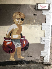 Boxer Boy Street Art - Dalkey, Ireland (ChrisGoldNY) Tags: wall mural art children child boxinggloves friendlychallenges challengewinners chrisgoldny chrisgoldphoto chrisgoldberg iphone bookcover albumcover licensing forsale ireland dalkey irish streetart boxers box graffiti eyepatch walls