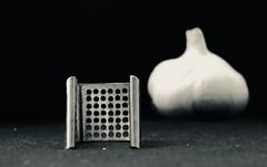Presse-ail - Garlic press (Charlotte P.Denoel) Tags: trous trou metal bw blackandwhite nb noiretblanc minimalism composition condiment food aliment nourriture clovegarlic presseail garlic ail