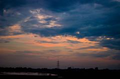 sky hues (Mainak Roy Camerawork) Tags: canon 600d sky silhouette sunset clouds flickr t3i blue orange scape landscape top sun shadow black noise
