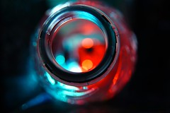 Catch the bokeh in a bottle HSoS (Ker Kaya) Tags: catch bokeh smileonsaturday catchthebokeh blue red reflections transparent round circle bottle kerkaya sony sonydscrx10m4 carlzeiss zeisslens hsos bottleneck macro