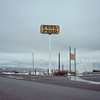 between nowhere and someplace else. 2015. (eyetwist) Tags: eyetwistkevinballuff eyetwist idaho sublett fuel food snowstorm snow sign analog film 6x6 120 landscape bleak barren mamiya 6mf 50mm portra 160 mamiya6mf mamiya50mmf4l kodakportra160 ishootkodak ishootfilm analogue emulsion mamiya6 square medium format primes filmexif icon epsonv750pro filmtagger 6 highdesert roadsideamerica americantypologies typology type typography typographic signgeeks roadside horizon mud puddle water pavement lonely boring banal eggleston ordinary american west sublettfuelstop middleofnowhere gas station gasoline i84 roadtrip america yellow muddy newtopographics nowhere