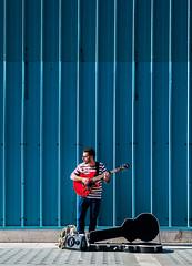 Strings (Peter Murrell) Tags: musician guitarist music busker busking oxfordstreet blue red londonstreetphotography london