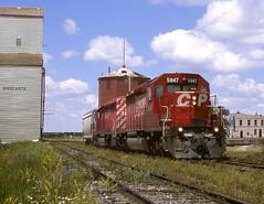 Binscarth MB Friday July 21st 2000 1355CDT (Hoopy2342) Tags: train rail railroad railway binscarth manitoba man canadianpacific canadianpacificrailway elevator watertower watertank prairie