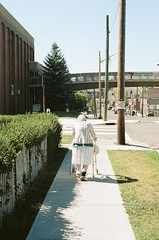 Out For a Stroll (mitchelldbarnes) Tags: kodak kodakfilm portra160 kodakportra160 portrait grandma streetphotography street sidewalk calgary canada canon canonae1 ae1 shootfilm filmisnotdead ishootfilm sun green old