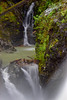 Through the mist (James_D_Images) Tags: nairnfalls provincialpark britishcolumbia pemberton whistler lilwatnation sacred waterfall greenriver rocks trees moss pool flow longexposure nd filter nature fallen log branches