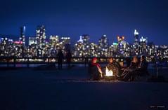 Saturday Night In The City (Clayton Perry Photoworks) Tags: vancouver bc canada spring explorebc explorecanada skyline fire beach campfire bokeh people night lights bonfire