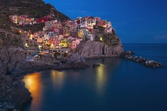 Manarola at Blue Hour (Alan Amati) Tags: amati alanamati europe italy italia manarola cinqueterre cinque terre coast sea seaside blue bluehour village town cliff terrace terraces harbor fishing mediterianian charming quaint picturesque hill liguria evening night coastline landscape beautiful topf25 laspezia