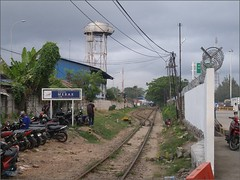 Banten Merak Station Path 20171229_073502 LG (CanadaGood) Tags: asia asean seasia indonesia indonesian java banten westjava javanese merak railway station keretaapi fence powerlines building canadagood 2017 thisdecade color colour morning track wall barbedwire motorcycle parking cameraphone tree watertower