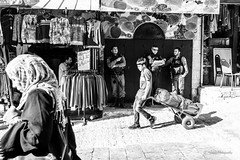 A typical morning in old town of Jerusalem . (Monica@Boston) Tags: documentaryimage islamicwomen shoppingarea shop store workingboy boy soldier policeofficer morning culture iceland jerusalem damascusgate city people monochrome blackandwhite