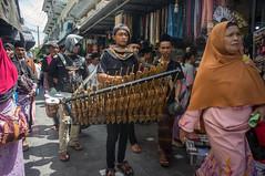 street musician near Ampel mosque (kuuan) Tags: streetmusicians amplemosque indonesia voigtländerheliarf4515mm manualfocus mf voigtländer15mm aspherical f4515mm superwideheliar apsc sonynex5n surabaya street java