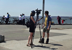 Rollerblader on the Street (Talking about the Summer-like Heat) (Robert S. Photography) Tags: caesarsbay spring heatwave interview camera rollerblader waterfront bicycles brooklyn nyc bathbeach sony dscwx150 iso100 may 2018