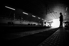 Stay Alone (明遊快) Tags: blackandwhite contrast japan station man people light shadow silhouette alone dark