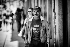 (graveur8x) Tags: man candid street portrait porto portugal blackandwhite look eyecontact people outside sun dof streetphotography strase europe bw schwarzweis cap contrast canon canoneos5dmarkiv 5d canonef135mmf2lusm 135mm f2