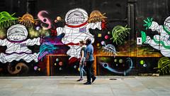 Cosmic (Sean Batten) Tags: london england unitedkingdom gb liverpoolstreet shoreditch city urban nikon df 50mm people streetphotography street candid pavement graffiti colors