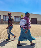 Opposite directions. (PJD-DigiPic) Tags: pjddigipic blue sky pedestrians baby man woman building somersetwest westerncapeprovince southafrica walking
