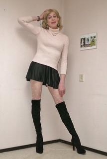 Mini-skirt and OTK boots.