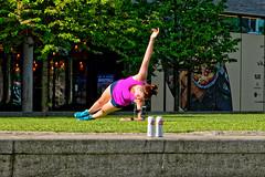Stella (Geoff Henson) Tags: woman beer cans tins stella grass athletic aerobics wall tree