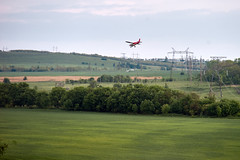 A small plane flying over fields and hills in the evening of May. North Caucasus (uiriidolgalev) Tags: a small plane flying over fields hills evening may north caucasus