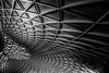 Triangular (Sean Batten) Tags: london england unitedkingdom gb kingscross trainstation blackandwhite bw architecture city urban nikon d800 35mm light shadow lines curves