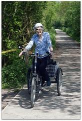 Mum on her Trike (zweiblumen) Tags: tricycle trike electric staffordshire england uk canoneos50d canonef50mmf14usm polariser zweiblumen picmonkey nationalroute55 sustrans