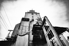 Decay (JCTopping) Tags: wideangle upward 19mm edinburgh tower silo 6d rural architecture grain canon blackandwhite indiana grainelevator unitedstates us perspective