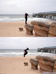 Back Flip by Boscombe Pier (Simon Downham) Tags: boscombe bournemouth pier boy lad gymnastics gym back flip acrobat acrobatics sea sand beach