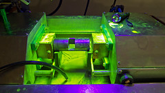 At school today: a work bench used for Magnetic Particle Testing, bathing in fluorescent UV-light. Currents of up to 3000 amperes are used in the bench to create magnetic fileds which surround the test piece. (Franz Airiman) Tags: ndt ofp magneticparticletesting mt magnetpulverprovning magnet magnetic magnetisk provning prov test testing ndttraingcenter nondestructivetesting oförstörandeprovning västerås skola school yrkesutbildning utbildning education iptekniker inspektionsochprovningstekniker uv uvljus uvlight fluorescent fluorescerande