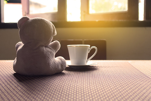 Alone teddy bear sitting on table, Sad concept.