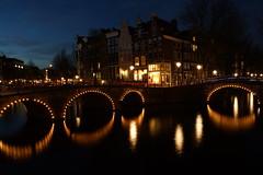 Amsterdam Circles (steve_whitmarsh) Tags: amsterdam netherlands city urban night lights building architecture bridge water canal abigfave