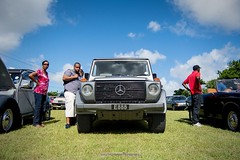 Check It Out (Nicky Highlander Photography) Tags: barbados barbadian caribbean westindies car carshow lights man woman watching look daily life lifestyle wide angle lens lowperspective grass outdoors cars countryside pasture photoessay photoshoot content saintthomas
