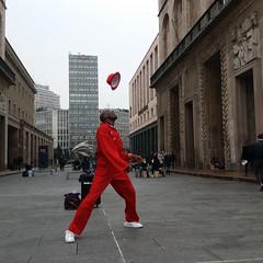 The black man in red (maurizio.s.) Tags: milano piazza del duomo black red hat campari samsung dance dancer music model architecture desing