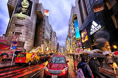 Colorful Shibuya in Tokyo, Japan (` Toshio ') Tags: toshio tokyo japan japanese asia shibuya downtown neon car busy crowded people shopping fashion street fujixt2 xt2 raining umbrella crossing road